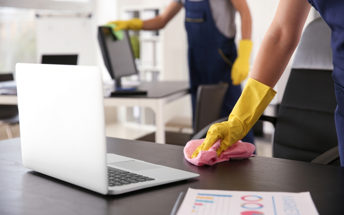 Janitor,Wiping,Table,In,Office